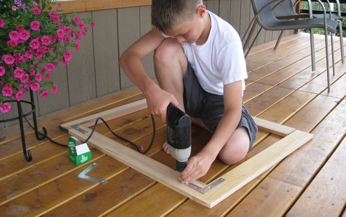 Connor building brooder box