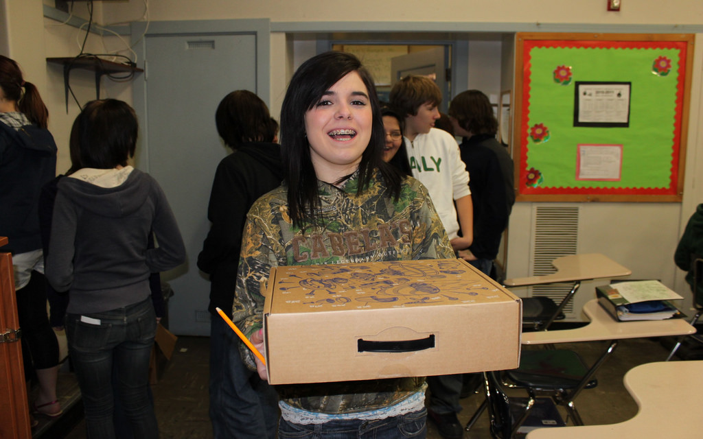 CCMS student receiving her Cr-48 box (Chromebook)